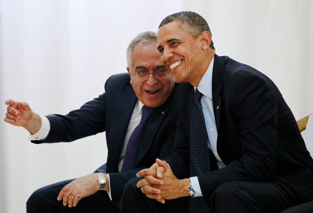 . U.S. President Barack Obama (R) watches a cultural event alongside Palestinian Prime Minister Salam Fayyad at the Al Bireh Youth Center in Ramallah March 21, 2013.   REUTERS/Jason Reed