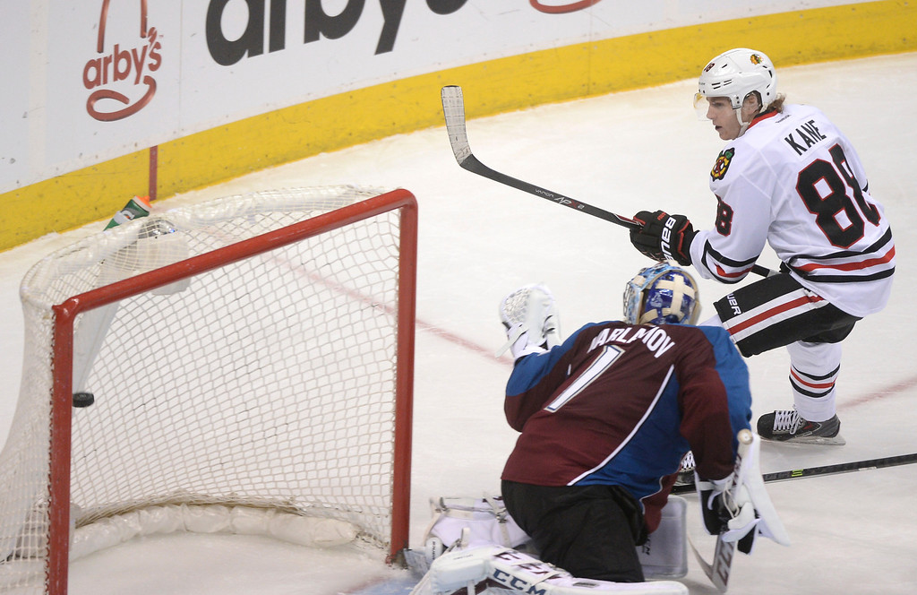 . Chicago wing Patrick Kane (88) lifted a shot over the shoulder of Colorado goaltender Semyon Varlamov (1) for a goal in the second period.  (Photo by Karl Gehring/The Denver Post)
