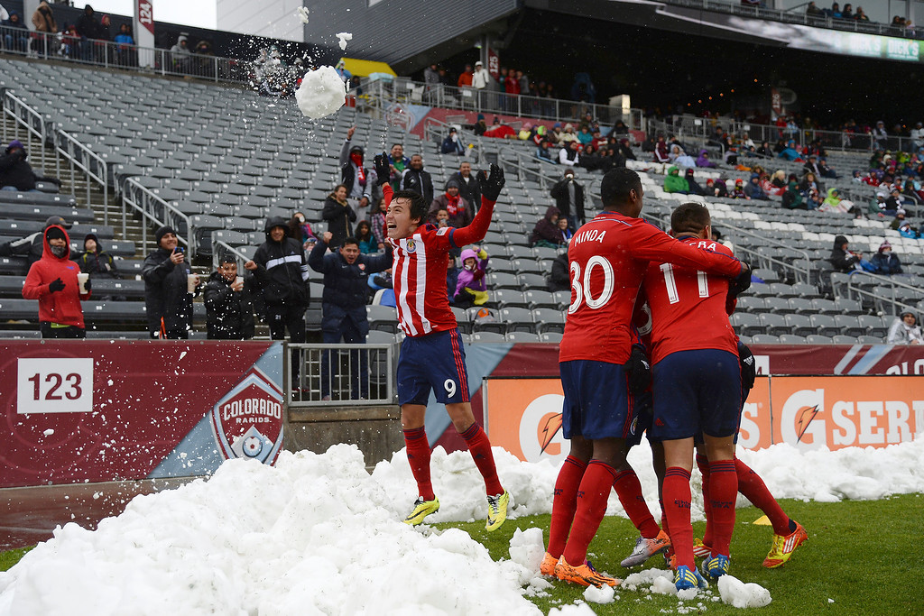 . Erick Torres (9) of Chivas USA throws a snowball into the air as teammates celebrates with Marvin Chavez (38) after he scored his first goal against the Colorado Rapids during the second half. Chivas USA defeated the Colorado Rapids 3-1 on Sunday, May 11, 2014. (Photo by AAron Ontiveroz/The Denver Post)
