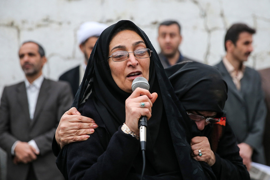 . Samereh Alinejad (C), the mother  of Abdolah Hosseinzadeh who was killed by a fellow Iranian, named Balal, in a street fight with a knife in 2007, speaks during Balal\'s execution ceremony in the northern city of Nowshahr on April 15, 2014.  AFP PHOTO/ARASH KHAMOOSHI/AFP/Getty Images