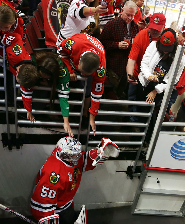 . CHICAGO, IL - JUNE 22: Fans cheer Goalie Corey Crawford #50 of Chicago Blackhawks as he takes the ice before the start of Game Five of the Stanley Cup Final at the United Center on June 22, 2013 in Chicago, Illinois. (Photo by Tasos Katopodis/Getty Images)