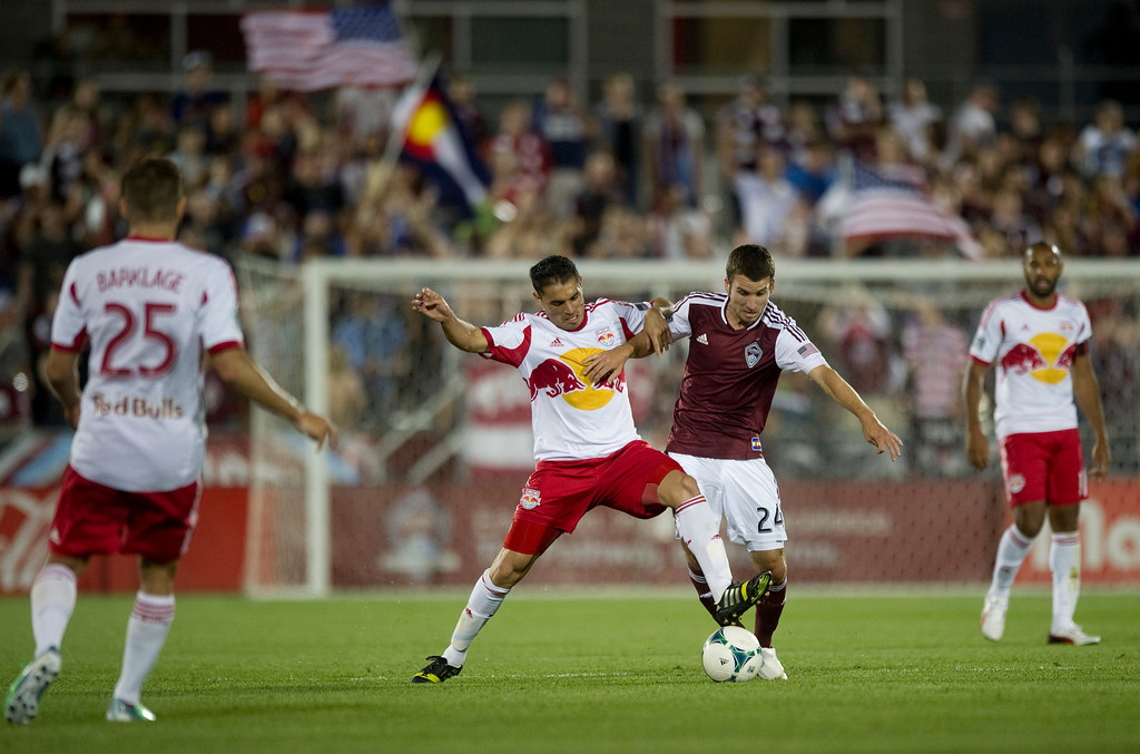 . DENVER - JULY 4: #9 of the New York Red Bulls Fabian Espindola fights for the ball against #24 Nathan Sturgis of the Colorado Rapids during the second half of a MLS soccer match against the New York Red Bulls on July 4, 2013 at Dick\'s Sporting Goods Park. The Rapids defeated the Red Bulls 2-0. (Photo By Grant Hindsley / The Denver Post)