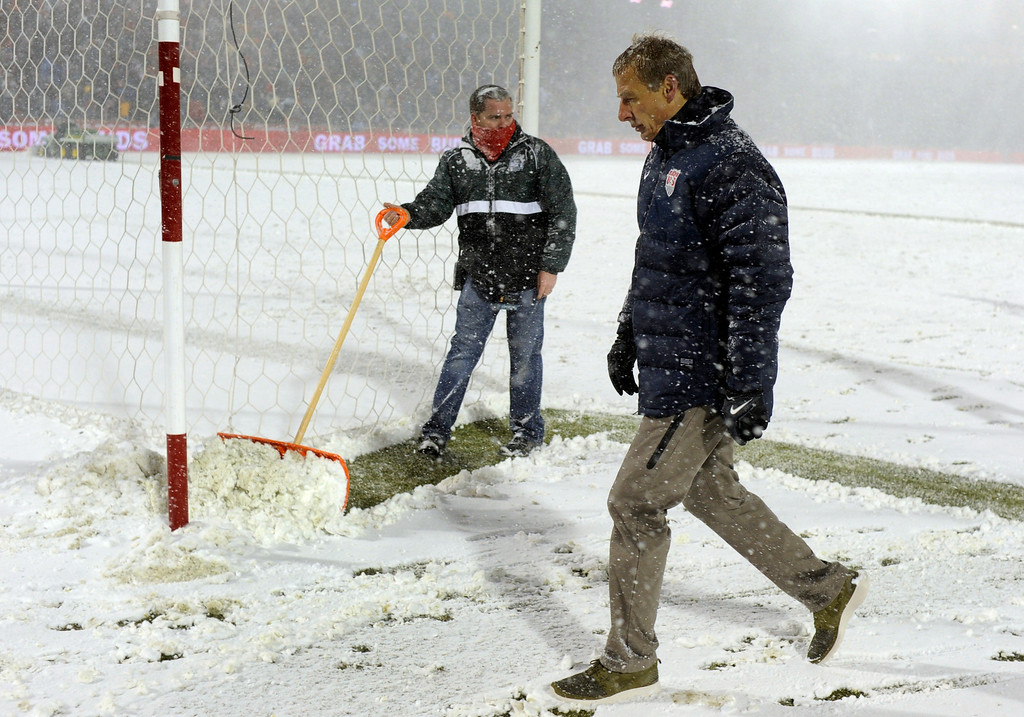 . COMMERCE CITY, CO. - MARCH 22: United State coach Jurgen Klinsmann headed to the locker room at halftime as weather conditions deteriorated. The U.S. Men\'s National Soccer Team hosted Costa Rica Friday night, March 22, 2013 in a FIFA World Cup qualifier at Dick\'s Sporting Goods Park in Commerce City.  (Photo By Karl Gehring/The Denver Post)