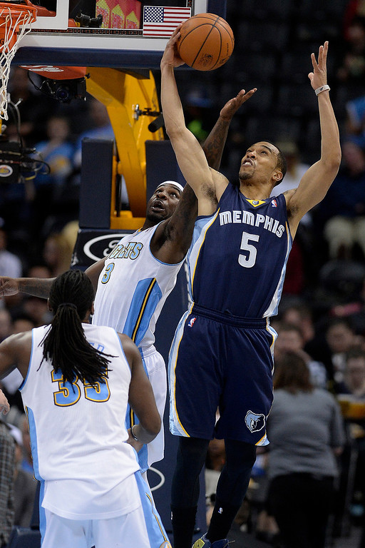 . Memphis Grizzlies guard Courtney Lee (5) grabs a rebound over Denver Nuggets guard Ty Lawson (3) during the third quarter of action. (Photo by AAron Ontiveroz/The Denver Post)