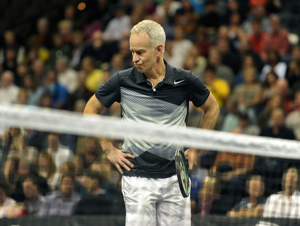 . John McEnroe quietly analyzed his own performance during a match with opponent Jim Courier thursday night. McEnroe won 6-4. McEnroe faced Jim Courier in a match at the Pepsi Center Thursday night, November 29, 2012. McEnroe is ranked second behind Courier in the 2012 PowerShares Series tour. Karl Gehring/ The Denver Post