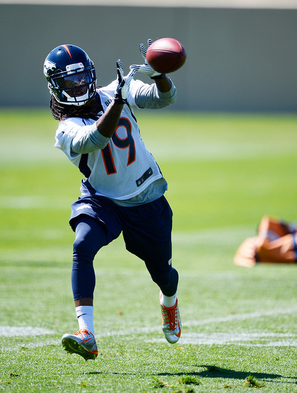 . Denver Broncos Isaiah Burse (19) catches a pass during practice May 28, 2014 at Dove Valley. (Photo by John Leyba/The Denver Post)