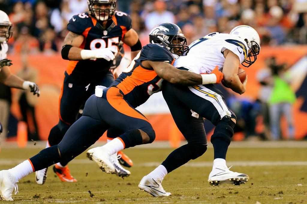 . Von Miller sacks Chargers quarterback Philip Rivers. (Joe Amon, The Denver Post)
