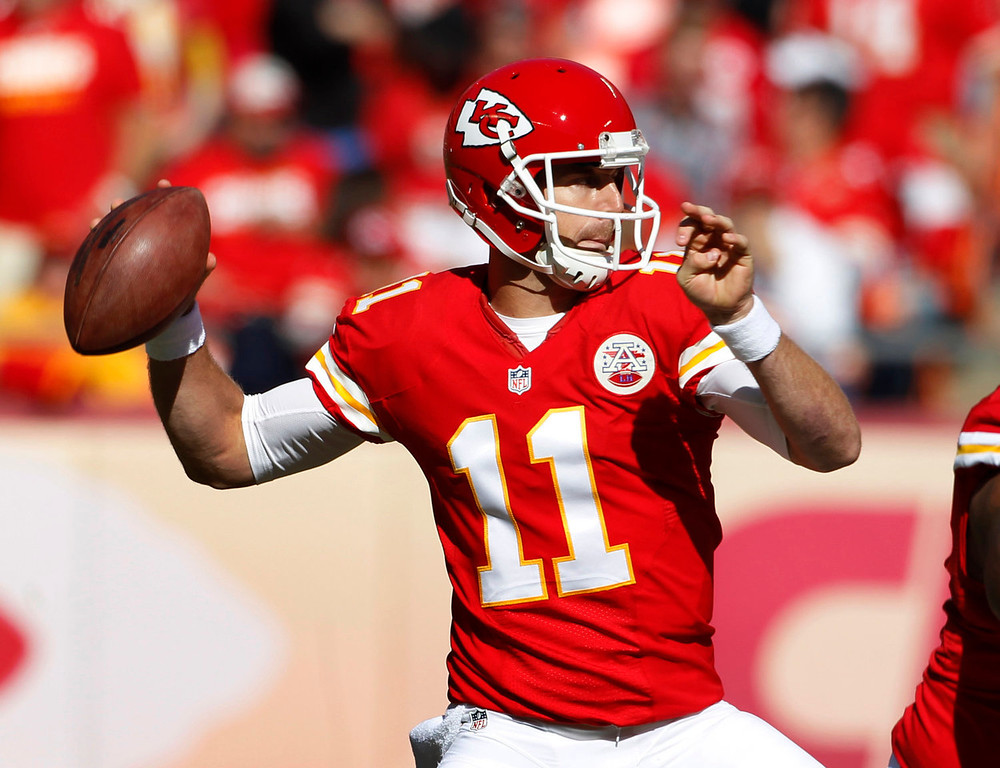 . Kansas City Chiefs quarterback Alex Smith (11) throws a pass during the first half of an NFL football game against the Cleveland Browns in Kansas City, Mo., Sunday, Oct. 27, 2013. (AP Photo/Colin E. Braley)