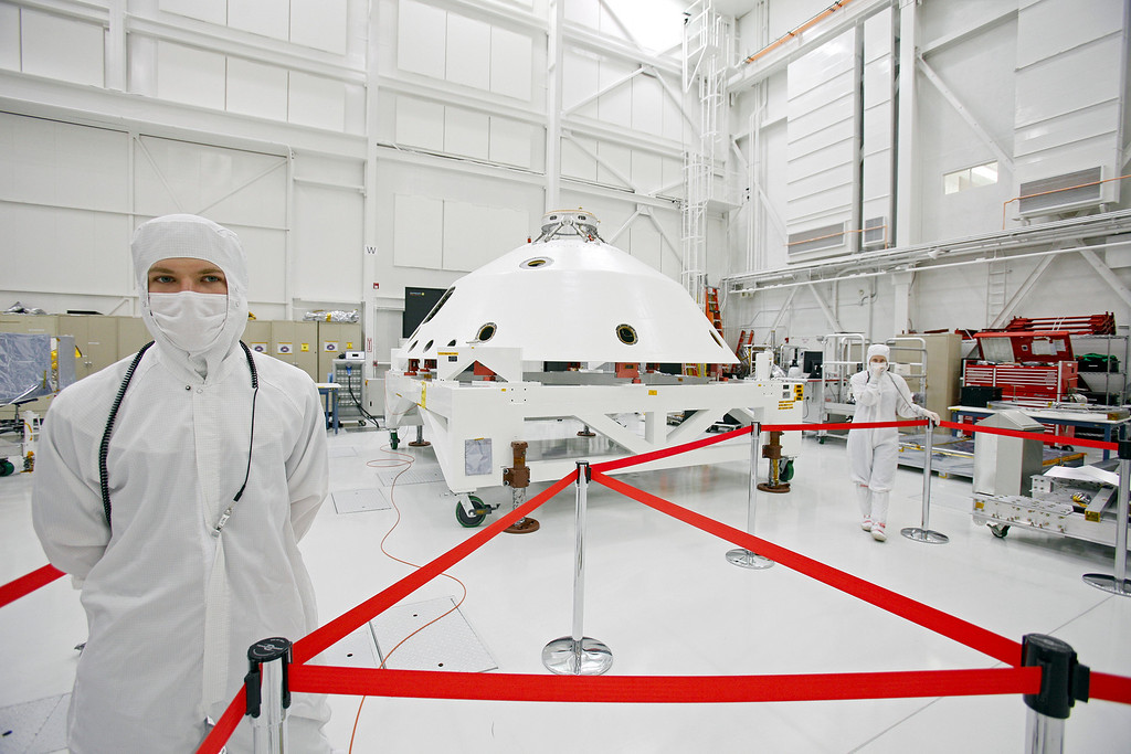 ". FILE - In this Monday, April 4, 2011 file photo, NASA engineers stand by Mars Science Laboratory\'s aeroshell, a conical enclosure that will help protect the rover ""Curiosity,\"" a robot the size of a car, from the searing temperatures of atmospheric entry when it lands on Mars, at the Jet Propulsion Laboratory in Pasadena, Calif. (AP Photo/Damian Dovarganes)"