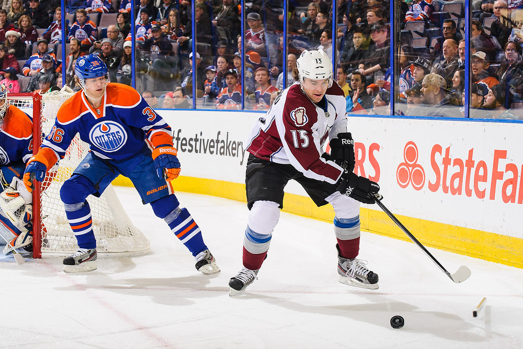 . EDMONTON, AB - DECEMBER 5: Philip Larsen #36 of the Edmonton Oilers gets his stick broken as he chases P.A. Parenteau #15 of the Colorado Avalanche during an NHL game at Rexall Place on December 5, 2013 in Edmonton, Alberta, Canada. (Photo by Derek Leung/Getty Images)