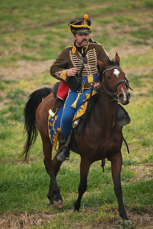 . A historical society enthusiast in the role of a Russian Hussar fighting against Napoleon arrives to re-enact The Battle of Nations on its 200th anniversary on October 20, 2013 near Leipzig, Germany. (Photo by Sean Gallup/Getty Images)