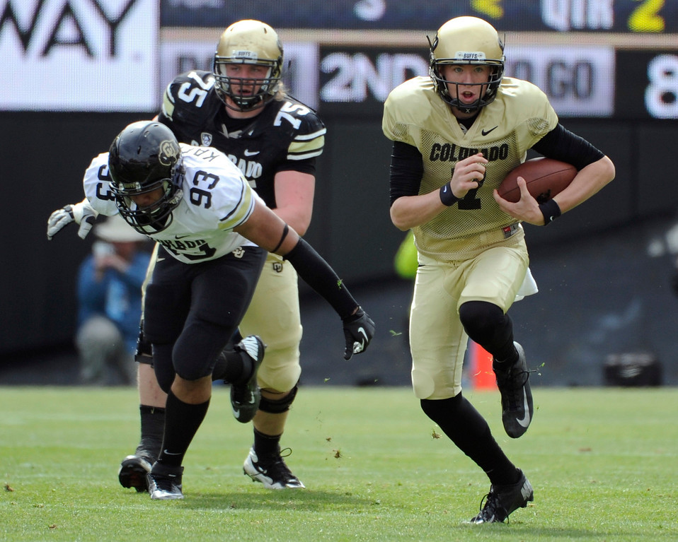 . BOULDER, CO.- APRIL13: Black QB Shane Dillon keeps the ball and turns up field. The University of Colorado football team hosts its spring football game at Folsom Field under the direction of new head coach Mike MacIntyre. (Photo By Kathryn Scott Osler/The Denver Post)