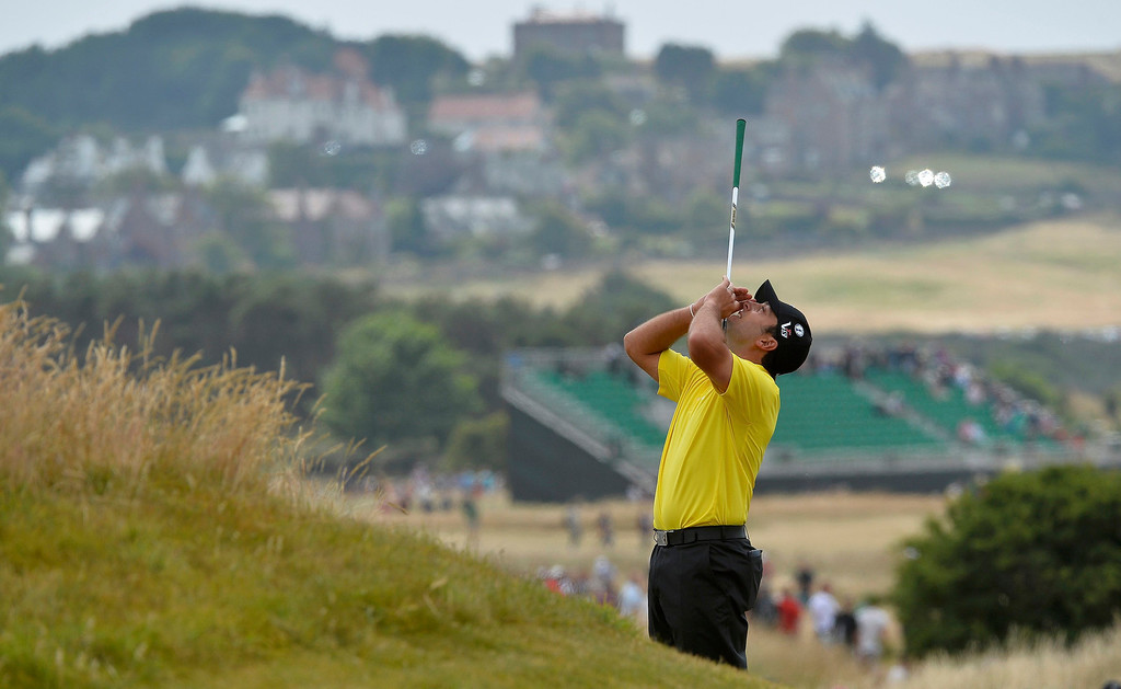 . Francesco Molinari of Italy reacts after missing his birdie putt on the fourth green during the final round of the British Open golf championship at Muirfield in Scotland July 21, 2013. REUTERS/Toby Melville