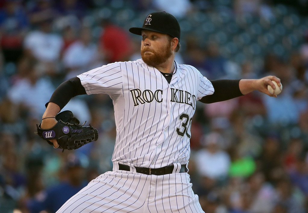. DENVER, CO - AUGUST 05:  Starting pitcher Brett Anderson #30 of the Colorado Rockies delivers against the Chicago Cubs at Coors Field on August 5, 2014 in Denver, Colorado.  (Photo by Doug Pensinger/Getty Images)