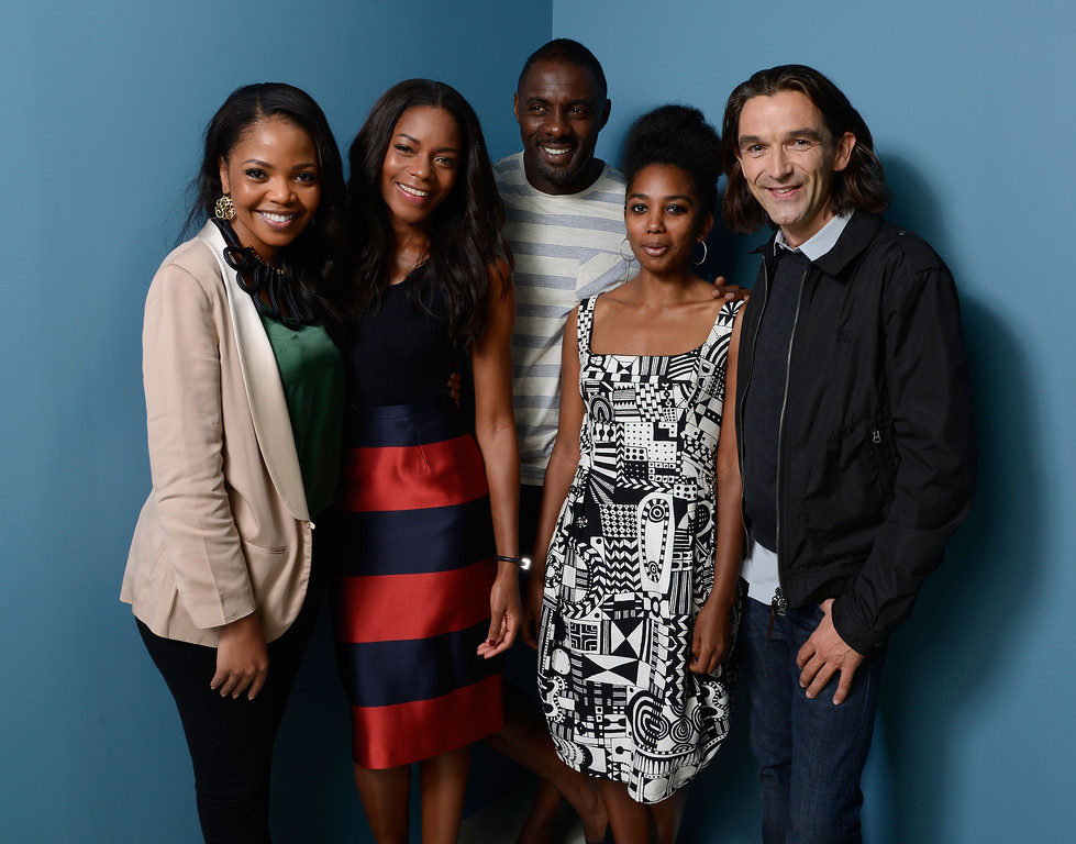 . (L-R) Actress Terry Pheto, actress Naomie Harris, actor Idris Elba, actress Lindiwe Matshikiza and director Justin Chadwick of \'Mandela: Long Walk to Freedom\' pose at the Guess Portrait Studio during 2013 Toronto International Film Festival on September 8, 2013 in Toronto, Canada.  (Photo by Larry Busacca/Getty Images)