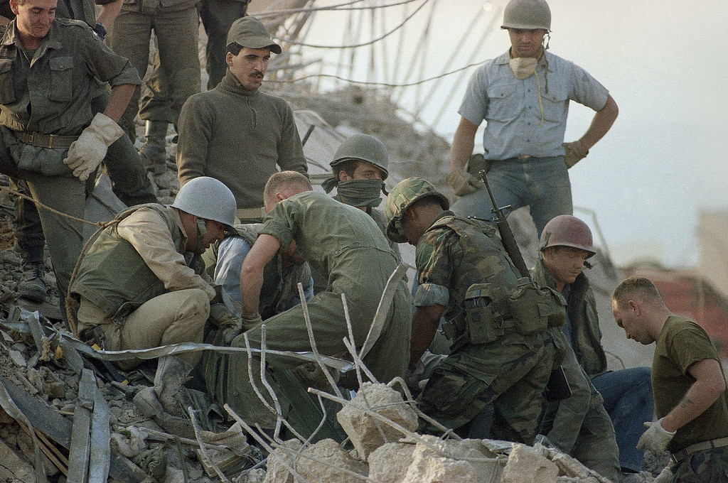 . This Sunday, Oct. 23, 1983, file photo shows service members digging through rubble after a truck bombing on the U.S. Marine barracks in Beirut, Lebanon. (AP Photo/Jim Bourdier, File)