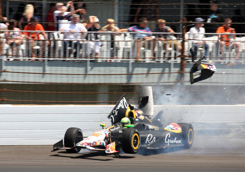 . Townsend Bell crashes in the second turn during the 98th running of the Indianapolis 500 IndyCar auto race at the Indianapolis Motor Speedway in Indianapolis, Sunday, May 25, 2014. The crash brought out the red flag to stop the race on lap 192.  (AP Photo/Mike Fair)