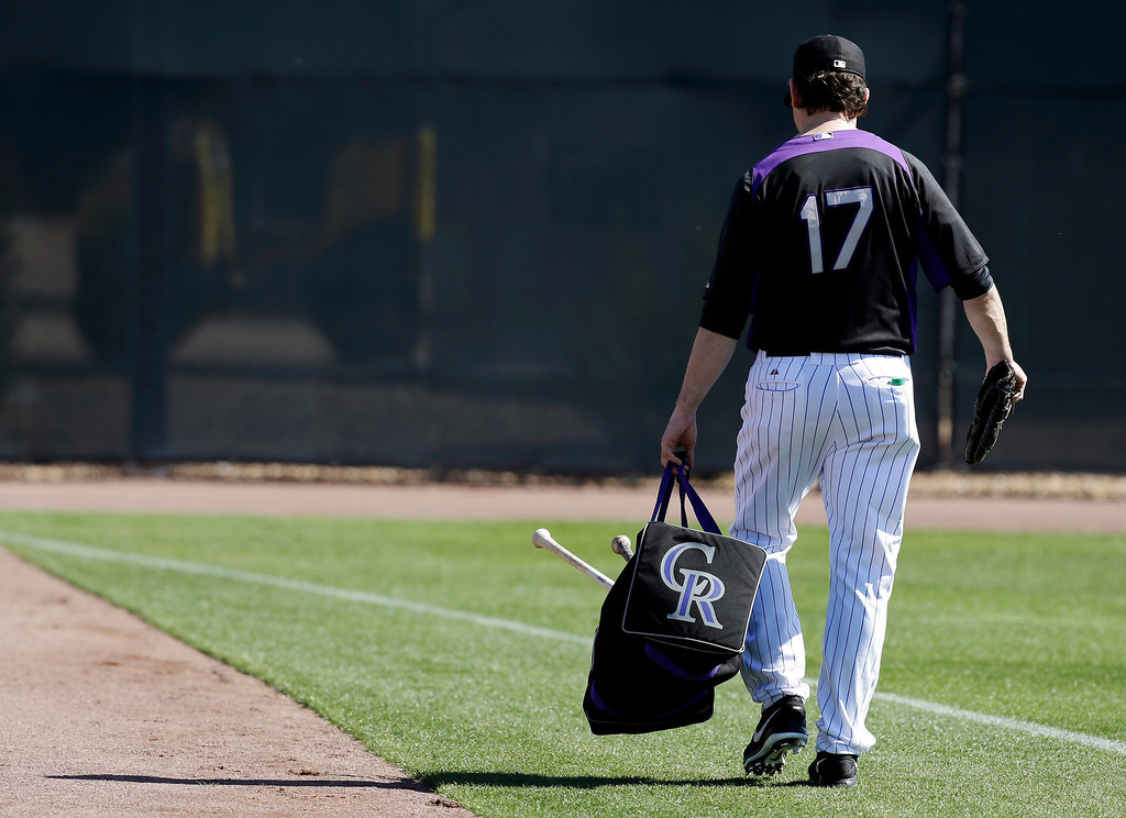 . Colorado Rockies\' Todd Helton walks to the outfield after batting practice during a spring training baseball workout, Sunday, Feb. 17, 2013, in Scottsdale, Ariz. (AP Photo/Darron Cummings)