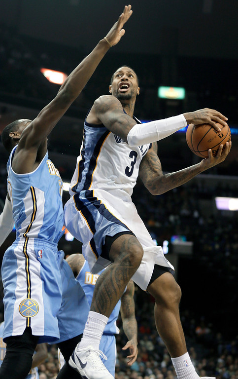 . Memphis Grizzlies\' James Johnson (3) goes to the basket in front of Denver Nuggets\' Quincy Miller, left, during the second half of an NBA basketball game in Memphis, Tenn., Saturday, Dec. 28, 2013. The Grizzlies defeated the Nuggets 120-99. (AP Photo/Danny Johnston)