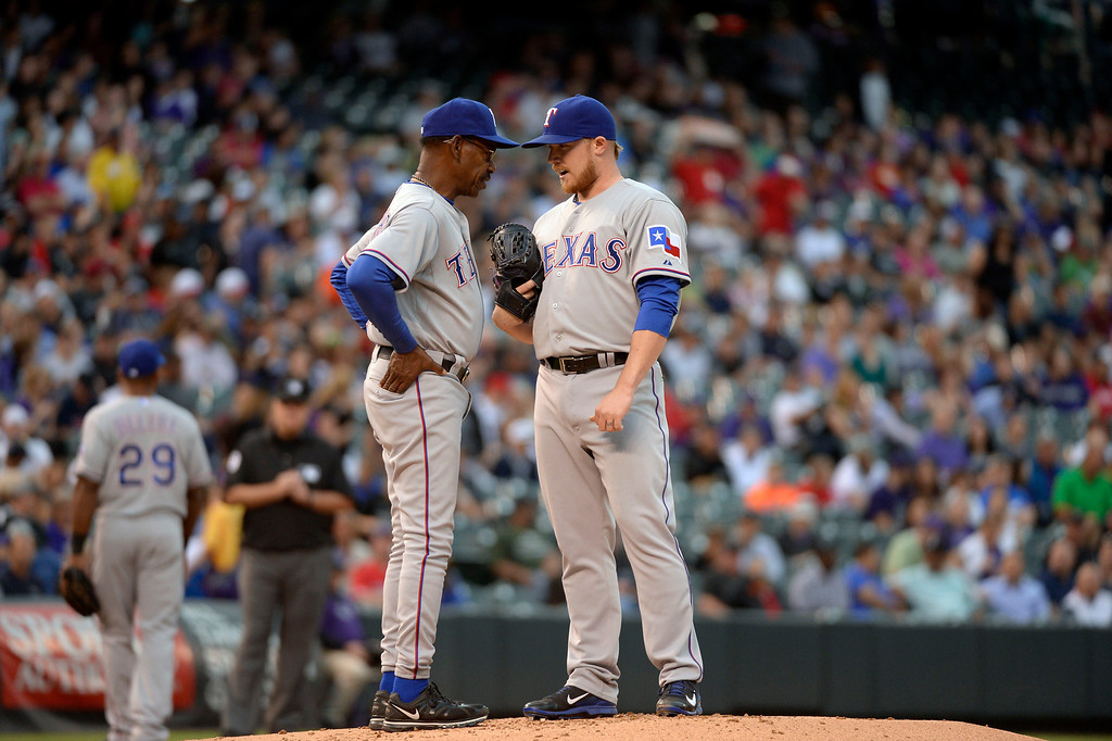 . DENVER, CO - MAY 06: Texas Rangers manager Ron Washington (38) pays a visit to the mound as he talks with Texas Rangers starting pitcher Robbie Ross (46) during the first inning May 6, 2014 at Coors Field. (Photo by John Leyba/The Denver Post)
