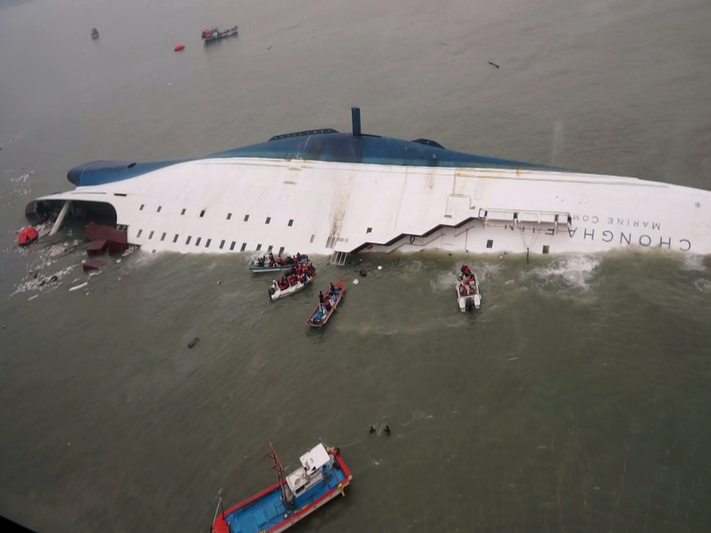 . This aerial photo taken at sea some 20 kilometers off the island of Byungpoong in Jindo on April 16, 2014 shows rescue operations underway for passengers on a South Korean ferry (C) that capsized on its way to Jeju island from Incheon. South Korean rescue teams, including elite navy SEAL divers, raced on April 16 to find up to 293 people missing from a capsized ferry carrying 459 passengers and crew -- mostly high school students bound for a holiday island. AFP PHOTO/YONHAPYONHAP/AFP/Getty Images