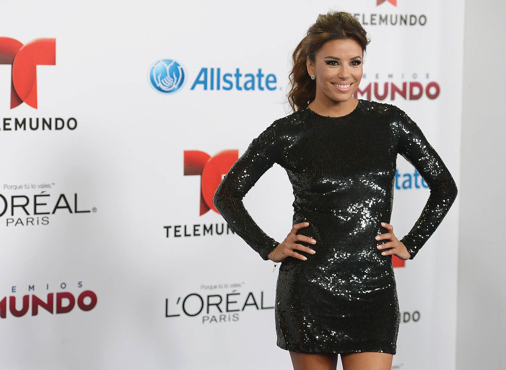 . MIAMI, FL - AUGUST 15: Actress  Eva Longoria arrives for Telemundo\'s Premios Tu Mundo Awards at American Airlines Arena on August 15, 2013 in Miami, Florida.  (Photo by Gustavo Caballero/Getty Images)