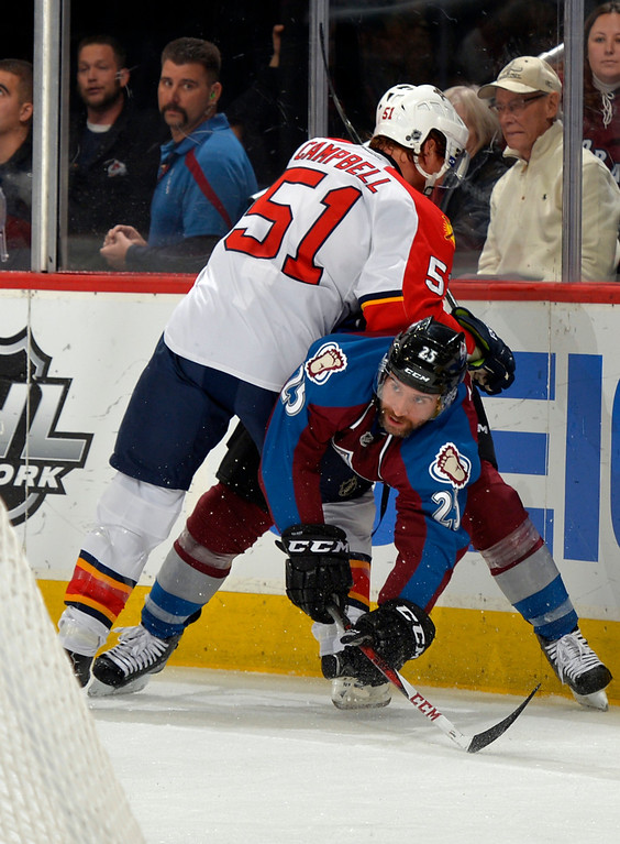 . Florida Panthers defenseman Brian Campbell (51) pushes down Colorado Avalanche center Maxime Talbot (25) during the first period of an NHL hockey game on Saturday, Nov. 16, 2013, in Denver. (AP Photo/Jack Dempsey)
