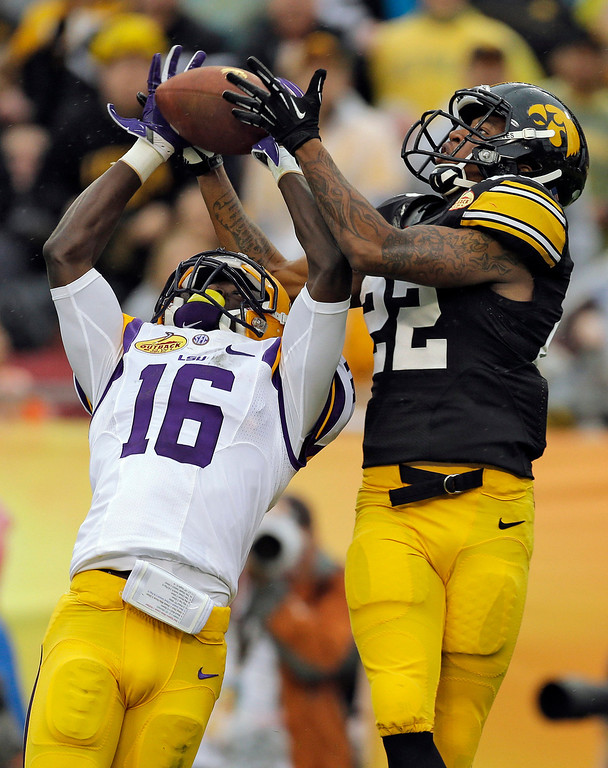 . LSU defensive back Tre\'Davious White (16) intercepts a pass intended for Iowa wide receiver Damond Powell (22) during the second quarter of the Outback Bowl NCAA college football game Wednesday, Jan. 1, 2014, in Tampa, Fla. (AP Photo/Chris O\'Meara)