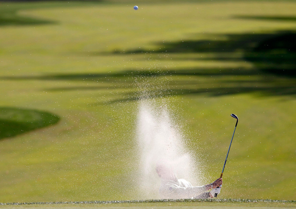 . Team Europe golfer Rory McIlroy of Northern Ireland hits from a sand trap on the 10th green during the morning foursomes round at the 39th Ryder Cup matches at the Medinah Country Club in Medinah, Illinois, September 28, 2012. REUTERS/Jeff Haynes