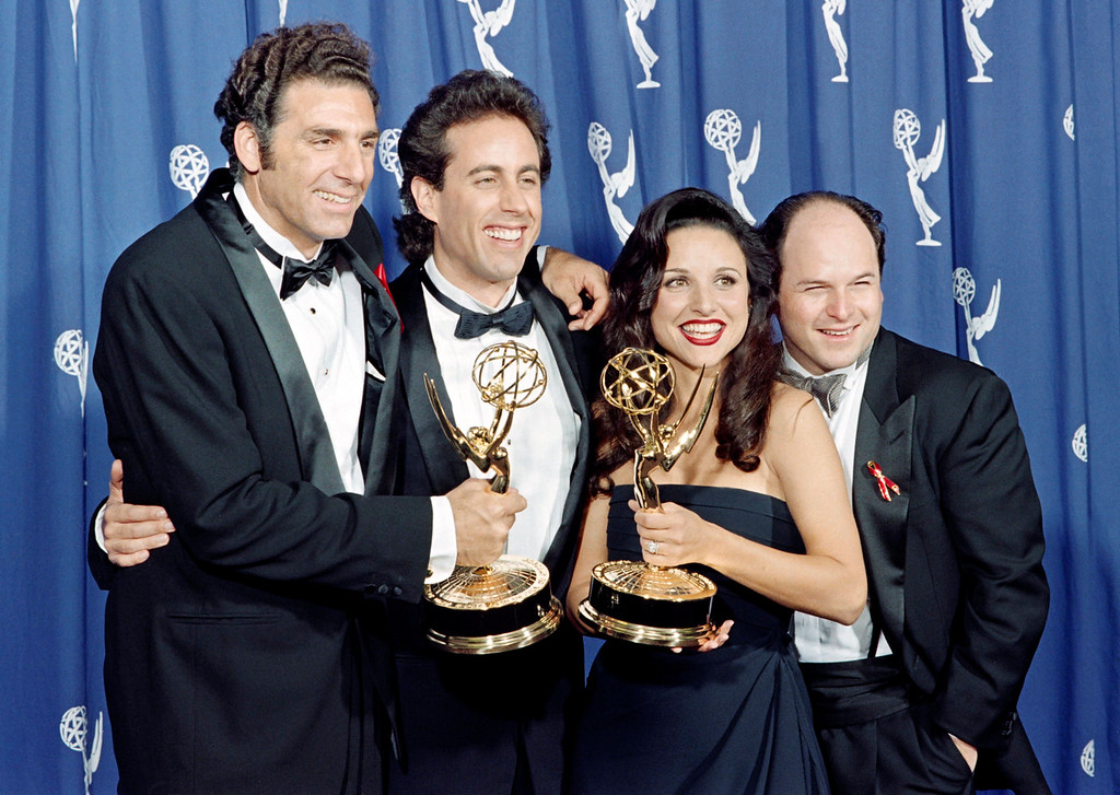 ". The cast of the Emmy-winning ""Seinfeld\"" show pose with the Emmys they won for Outstanding Comedy Series on September 19, 1993 in Pasadena, CA. From left to right:  Michael Richards, Jerry Seinfeld, Julia Louis-Dreyfus and Jason Alexander. (SCOTT FLYNN/AFP/Getty Images)"