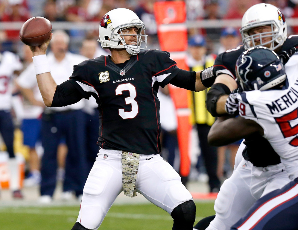 . Arizona Cardinals quarterback Carson Palmer (3) throws during the first half of an NFL football game as Houston Texans outside linebacker Whitney Mercilus pursues Sunday, Nov. 10, 2013, in Glendale, Ariz. (AP Photo/Ross D. Franklin)