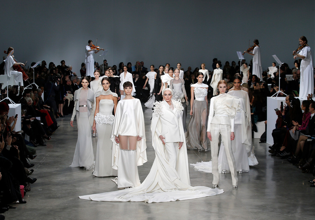 . American model and actress Carmen Dell\'Oresice, 82, center, and other models present creations by French fashion designer Stephane Rolland for his Spring Summer 2013 Haute Couture fashion collection, presented in Paris, Tuesday, Jan.22, 2013. (AP Photo/Christophe Ena)