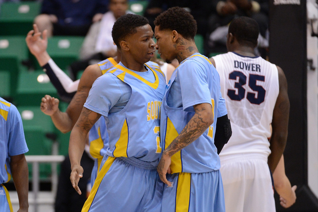 . SALT LAKE CITY, UT - MARCH 21:  YonDarius Johnson #23 and Derick Beltran #2 of the Southern University Jaguars celebrate in the first half while taking on the Gonzaga Bulldogs during the second round of the 2013 NCAA Men\'s Basketball Tournament at EnergySolutions Arena on March 21, 2013 in Salt Lake City, Utah.  (Photo by Harry How/Getty Images)