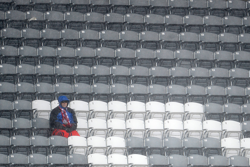 . A lone fan remains in the fans at the conclusion of the second half between the Colorado Rapids and Chivas USA. Chivas USA defeated the Colorado Rapids 3-1 on Sunday, May 11, 2014. (Photo by AAron Ontiveroz/The Denver Post)