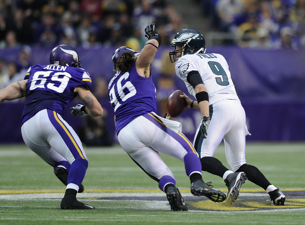 . Nick Foles #9 of the Philadelphia Eagles scrambles with the ball as Jared Allen #69 and Brian Robison #96 of the Minnesota Vikings give chase during the second quarter of the game on December 15, 2013 at Mall of America Field at the Hubert H. Humphrey Metrodome in Minneapolis, Minnesota. (Photo by Hannah Foslien/Getty Images)