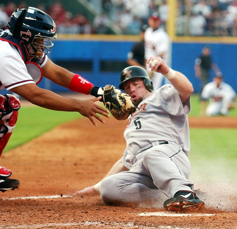 . JEFF BAGWELL -- Houston Astros\' Jeff Bagwell scores as Atlanta Braves catcher Johnny Estrada tries to make the tag on a double by Jeff Kent in the fifth inning during Game 1 of the National League Division Series at Turner Field in Atlanta on Oct. 6, 2004. (AP Photo/John Bazemore)