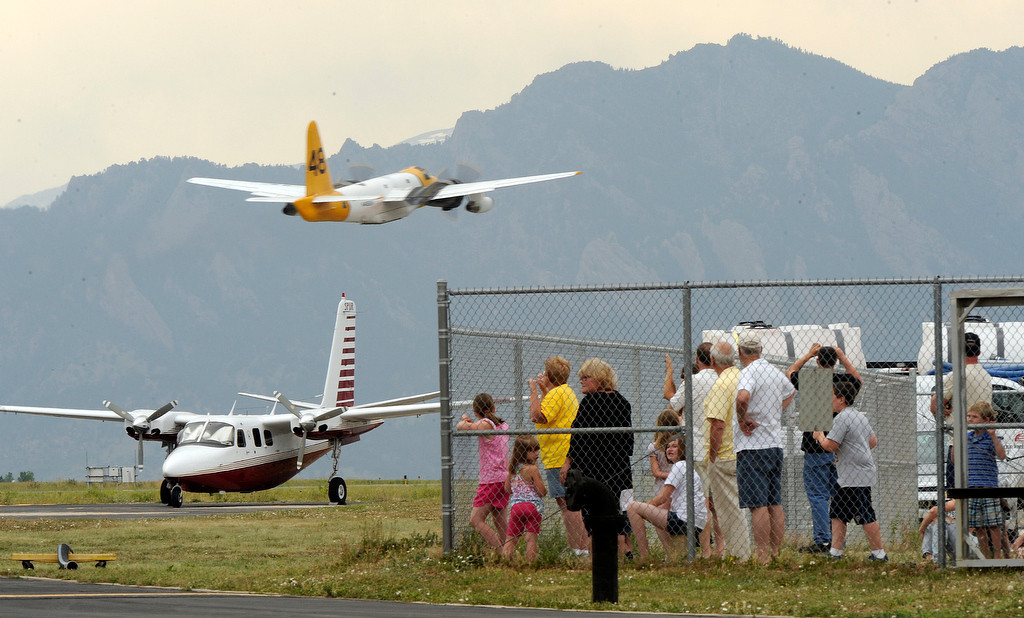 . The Rocky Mountain Metropolitan Airport in Broomfield was buzzing at the Jeffco Airtankers Base for the refilling of retardant on the fire fighting aircraft on Tuesday, June 12, 2012. Spectators watch as the  tankers began flying missions to the High Park Fire in the mid afternoon. Cyrus McCrimmon, The  Denver Post