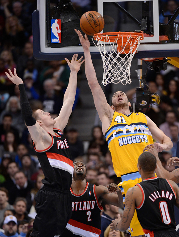 . Denver Nuggets center Kosta Koufos (41) tries to tip in a rebound late in the fourth quarter on Portland Trail Blazers small forward Luke Babbitt (8)  Tuesday, January 15, 2013 at Pepsi Center. John Leyba, The Denver Post