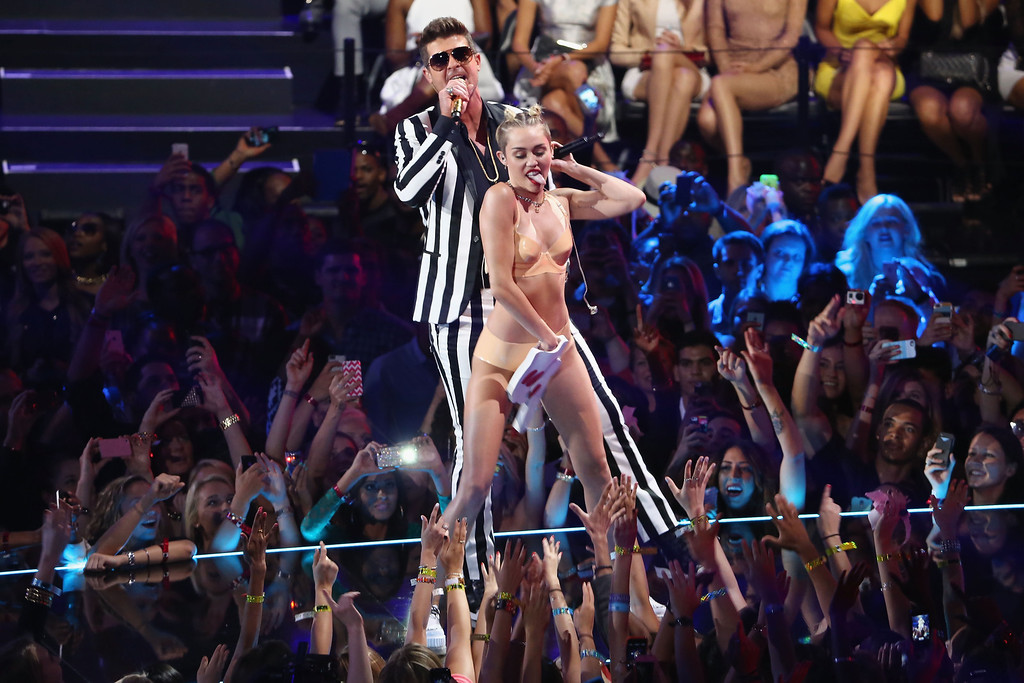 . Miley Cyrus and Robin Thicke perform onstage during the 2013 MTV Video Music Awards at the Barclays Center on August 25, 2013 in the Brooklyn borough of New York City.  (Photo by Neilson Barnard/Getty Images for MTV)