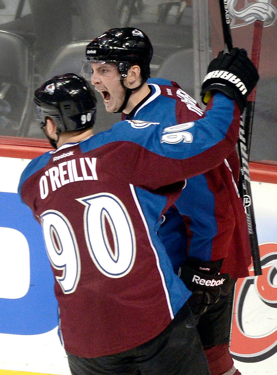 . Matt Duchene celebrated with line mate Ryan O\'Reilly following Duchene\'s goal in the second period. (Photo by Karl Gehring/The Denver Post)