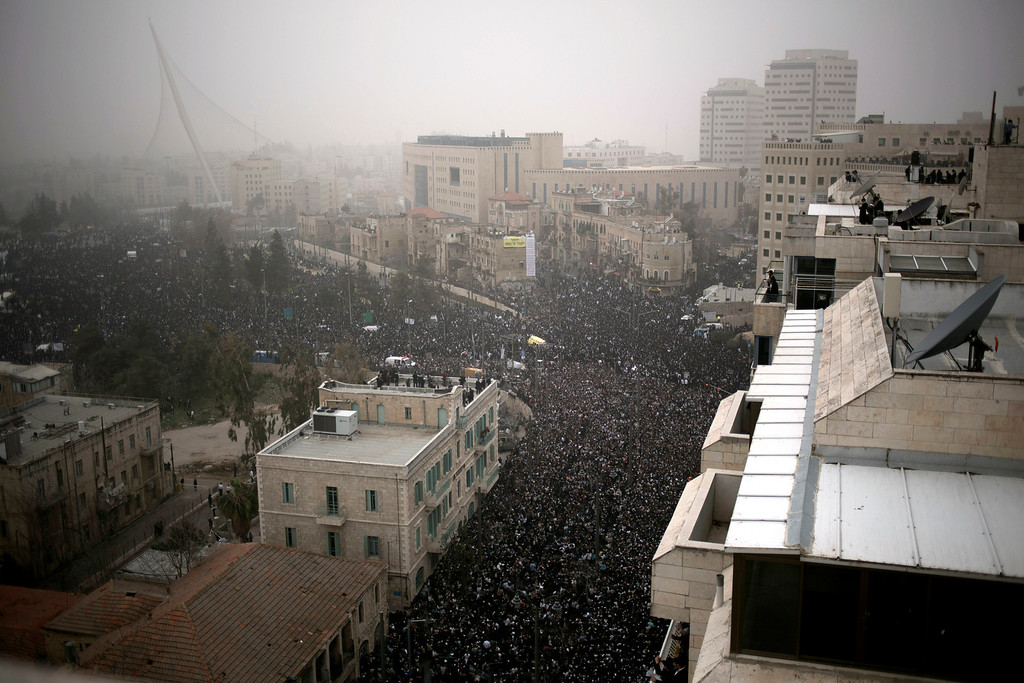 . Hundreds of thousands of ultra-Orthodox Jews rally in a massive show of force against plans to force them to serve in the Israeli military, blocking roads and paralyzing the city of Jerusalem, Sunday, March 2, 2014. The widespread opposition to the compulsory draft poses a challenge to the country, which is grappling with a cultural war over the place of the ultra-Orthodox in Israeli society. With secular Jews required to serve, the issue is one of the most sensitive flash points between Israel\'s secular majority and its devout minority. (AP Photo/Ariel Schalit)