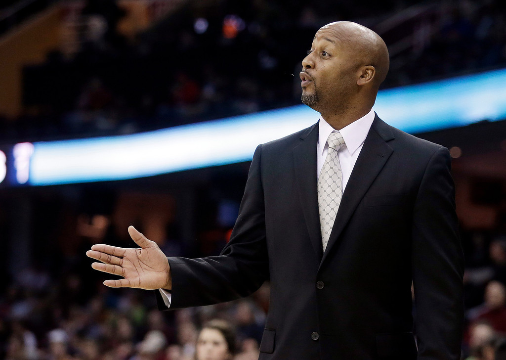 . Denver Nuggets head coach Brian Shaw reacts during the first quarter of an NBA basketball game  against the Cleveland Cavaliers, Wednesday, Dec. 4, 2013, in Cleveland. The Cavaliers won 98-88. (AP Photo/Tony Dejak)