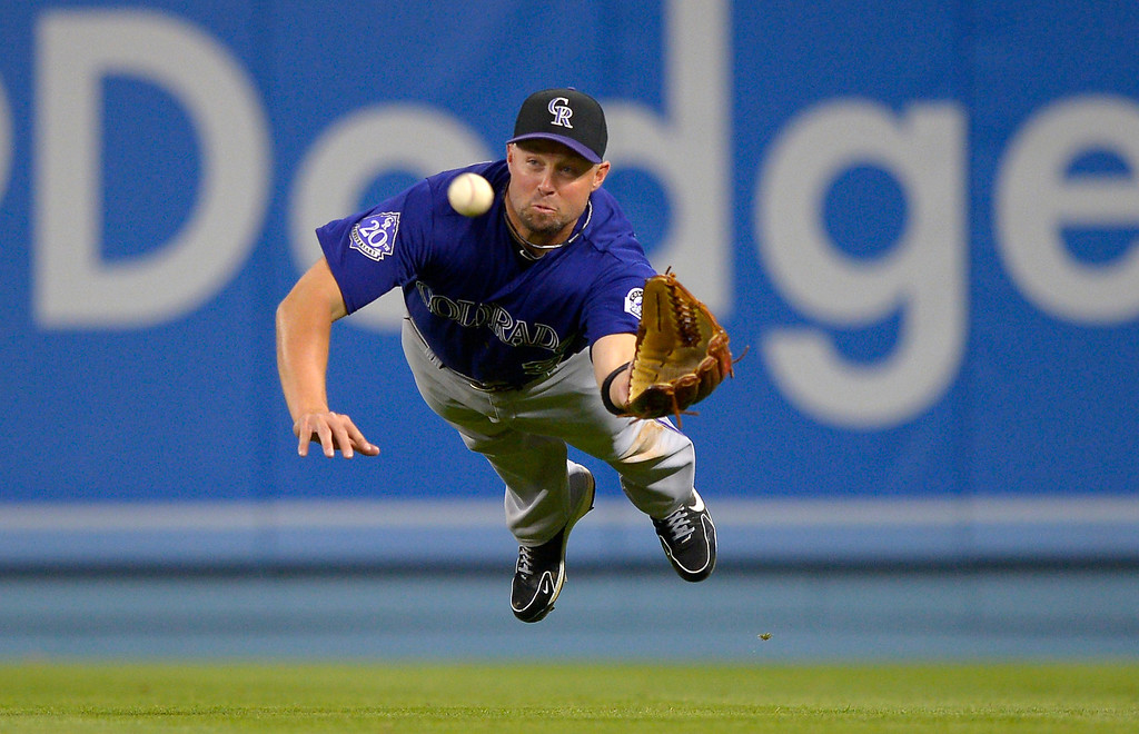. Colorado Rockies right fielder Michael Cuddyer makes a catch on a ball hit by Los Angeles Dodgers\' Luis Cruz during the eighth inning of their baseball game, Tuesday, April 30, 2013, in Los Angeles.   (AP Photo/Mark J. Terrill)