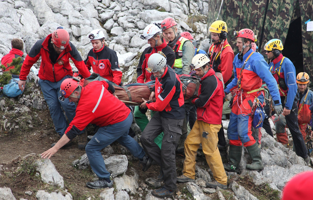 . In this handout photo provided by the Bavarian Mountain Patrol (Bergwacht Bayern), rescue workers carry injured spelunker Johann Westhauser after they brought him to the surface from the Riesending vertical cave during the final phase of his rescue on June 19, 2014 near Marktschellenberg, Germany. (Photo by Bergwacht Bayern via Getty Images)