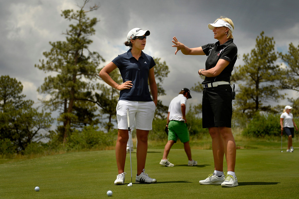 . Carlota Ciganda of Spain listens to 2013 European Solheim Cup Team Captain Liselotte Neumann on the course as they take a look at the Colorado Golf Club. (Photo By Joe Amon/The Denver Post)