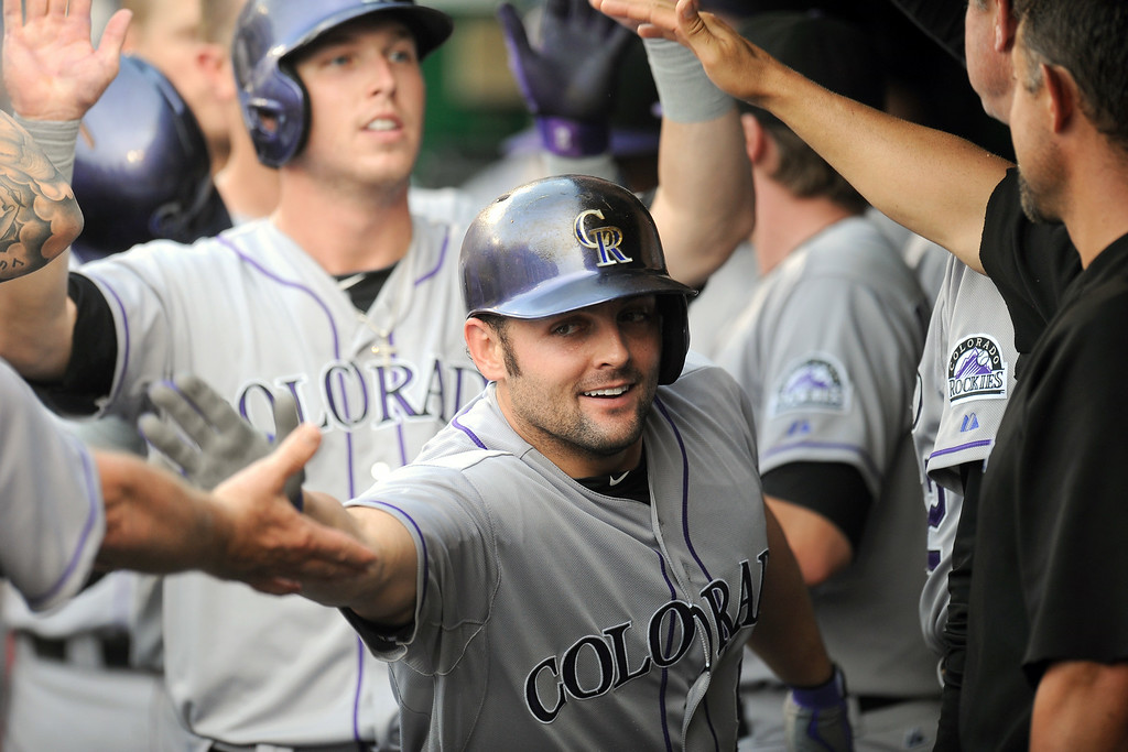 . Michael McKenry #8 of the Colorado Rockies celebrates a three run home run in the second inning during a baseball against the Washington Nationals on July 2, 2014 at Nationals Park in Washington, DC. (Photo by Mitchell Layton/Getty Images)