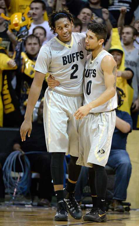 . Colorado Buffaloes forward Xavier Johnson (2) an dColorado Buffaloes guard Askia Booker (0) hug during the last minutes of the second half as they defeat the Oregon Ducks 100-91 January 5, 2014 at Coors Events Center. (Photo by John Leyba/The Denver Post)