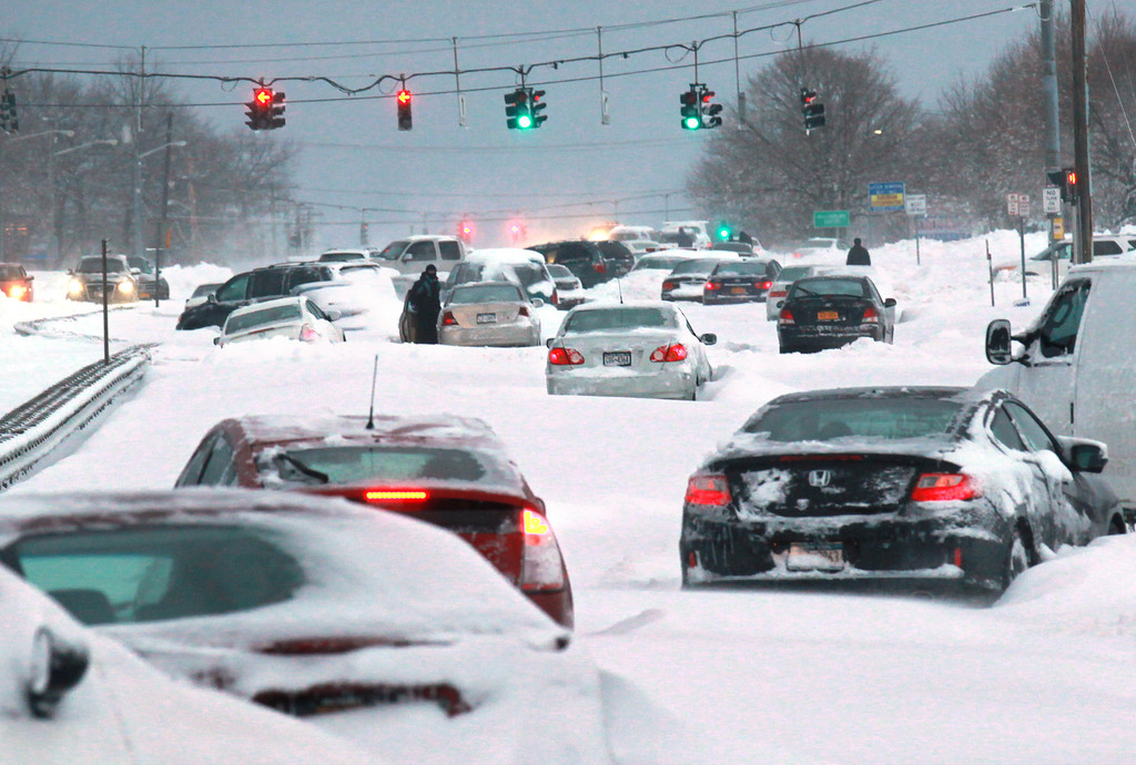 . Snowbound vehicles remain stranded Saturday morning, Feb. 9, 2013 along Route 347 in Lake Grove, N.Y. Hundreds of cars were stranded on New York�s Long Island roadways as snow rapidly covered roadways. Many people abandoned their vehicles and first responders rescued motorists who chose to spend the frigid night in their vehicles.  (AP Photo/Newsday, John Paraskevas)