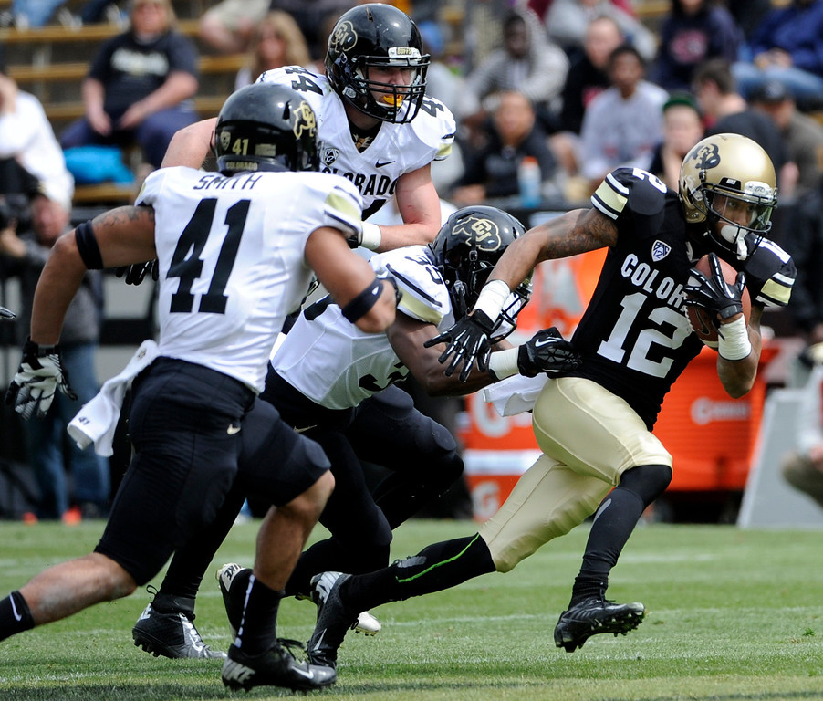 . BOULDER, CO.- APRIL13: Keenan Canty outpaces his teammates and makes his way down field. The University of Colorado football team hosts its spring football game at Folsom Field under the direction of new head coach Mike MacIntyre. (Photo By Kathryn Scott Osler/The Denver Post)