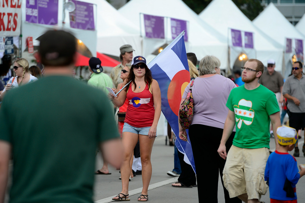 . DENVER, CO - AUGUST 29: Kelsey Hurd shows off the clothing from Colorado Love Clothing. Hungry visitors make their way to the opening day of A Taste of Colorado at Civic Center Park in downtown Denver on Friday, Aug. 29, 2014. The food and music festival runs through Labor Day Weekend. (Kathryn Scott Osler/The Denver Post)